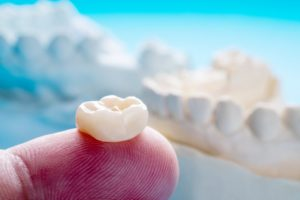 close up of a dental crown on a person's finger